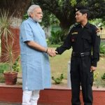 Laksham Singh Bisht with Narendra Modi while serving as NSG Commando. by .