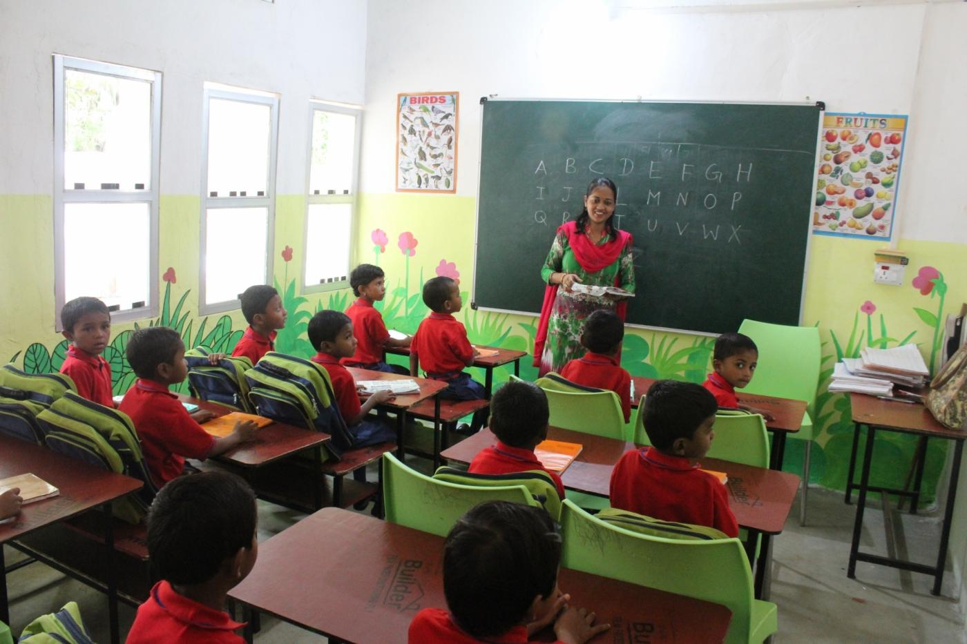 Equipped with modern classrooms, the school introduces tribal children for the first time to picture books, toys, and even computers. by .