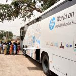 """Students ready to board """"HP World on Wheels"""" (WoW), buses that are already driving digital literacy in rural India. by ."""