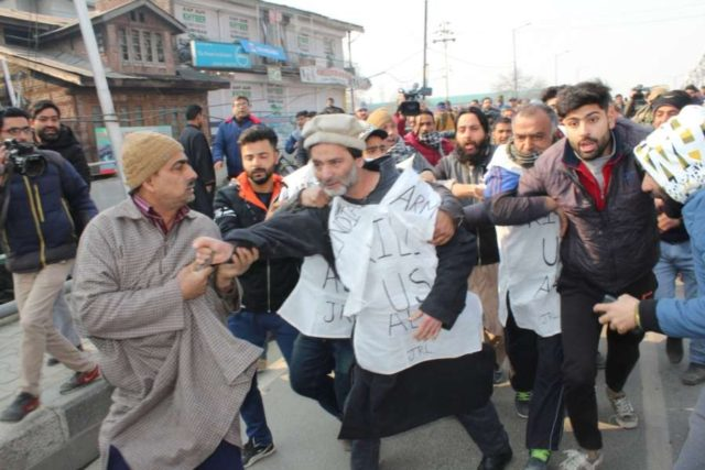 Srinagar: Jammu and Kashmir Liberation Front (JKLF) chairman Yasin Malik detained while he was leading a protest march against the civilian killings which took place in Pulwama district, to the Army headquarters in Srinagar on Dec 17, 2018. (Photo: IANS) by .
