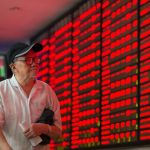 An investor in the trading hall of a Chinese securities firm in Nanjing, China. (File Photo: Xinhua/Su Yang/IANS) by .