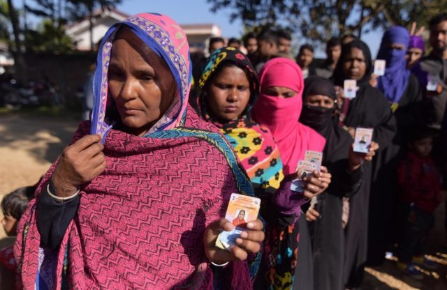 Hojai: Women cast their votes during the second phase of Assam Panchayat polls in Hojai district of the state on Dec 9, 2018. (Photo: IANS) by .