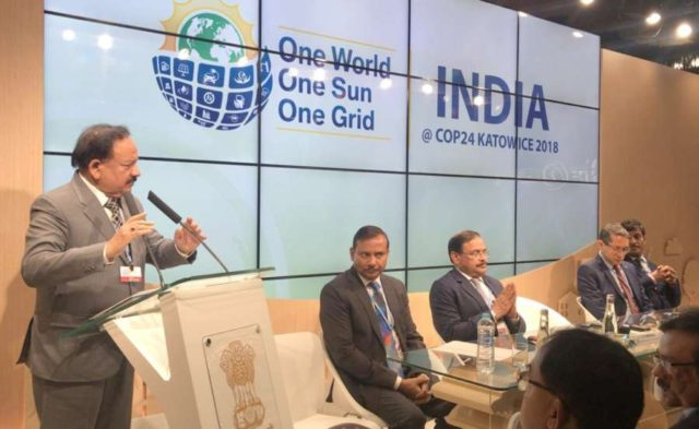 Katowice: Union Minister for Science & Technology, Earth Sciences and Environment, Forest & Climate Change, Dr. Harsh Vardhan addresses at the inauguration of the Indian Pavilion at COP24 in Katowice, Poland on Dec 3, 2018. Also seen Ministry of Environment, Forest and Climate Change Secretary C.K. Mishra. (Photo: IANS/PIB) by .