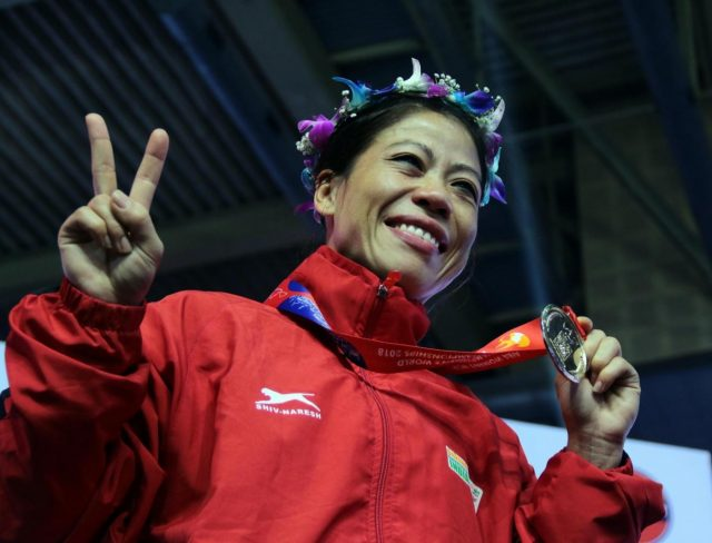 New Delhi: Indian boxing legend M.C. Mary Kom poses with her gold medal after she defeated Ukraine's Hanna Okhota during a final match in the light flyweight 48 kilogram category during the 10th AIBA Women's World Boxing Championships in New Delhi, on Nov 24, 2018. Mary Kom scripted history by clinching a record sixth World Championship Gold medal in the light flyweight 48 kilogram category after outclassing Ukraine's Hanna Okhota 5:0. (Photo: IANS) by .