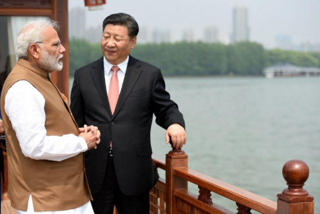 Wuhan: Prime Minister Narendra Modi and Chinese President Xi Jinping inside a house boat, in Wuhan on April 28, 2018. (Photo: IANS/PIB) by .