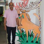 Kanha's Assistant Director S.K. Khare, who gave up his bungalow for the school, stands beside the school mascot 'Bhoorsingh the Barasingha'. by .