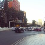 Traffic in downtown Kunming. by .