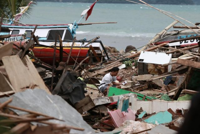 LAMPUNG, Dec. 24, 2018 (Xinhua) -- A man looks for salvageable items among the debris after a tsunami hit beach at Rajabasa Village in South Lampung, Indonesia, Dec. 23. 2018. The death toll from a volcano-triggered tsunami in Indonesia rose to 222 with at least 843 others injured, the disaster management agency confirmed on Sunday, while the figures are feared to mount as damage verification goes on. (Xinhua/Langit/IANS) by .