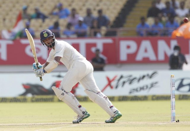 Rajkot: India's Cheteshwar Pujara in action during the 1st Test match between India and West Indies at Saurashtra Cricket Association Stadium in Rajkot on Oct 4, 22018. (Photo: Surjeet Yadav/IANS) by .