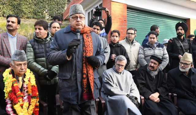 Srinagar: National Conference (NC) President Farooq Abdullah addresses during a programme where expelled PDP leaders Basharat Bukhari and Peer Muhammad Hussain joined NC in Srinagar, on Dec 19, 2018. Also seen NC leader Omar Abdullah. (Photo: IANS) by .
