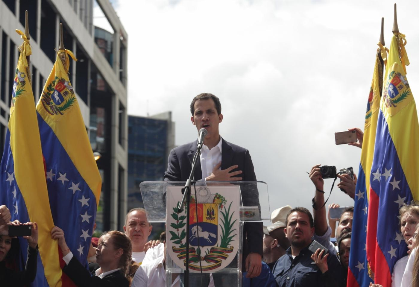 """Juan Guaido (C), head of the opposition-controlled National Assembly, delivers a speech at the Francisco de Miranda avenue, in Caracas, Venezuela, on Jan. 23, 2019. Venezuelan President Nicolas Maduro on Wednesday announced he was severing """"diplomatic and political"""" ties with the United States after the U.S. authorities recognized the opposition leader Juan Guaido as the nation's interim president. (Xinhua/Boris Vergara/IANS) by ."""