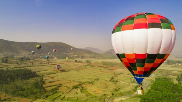 Hot air balloons flying over Araku valley. by .
