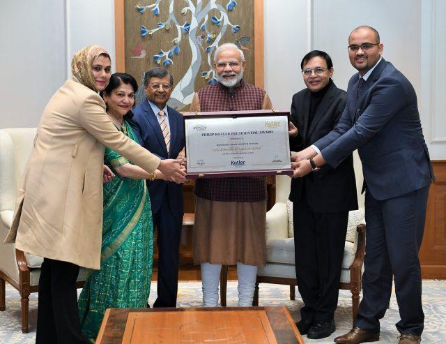 New Delhi: Prime Minister Narendra Modi receives the Philip Kotler Presidential award in New Delhi, on Jan 14, 2019. (Photo: IANS/PIB) by .