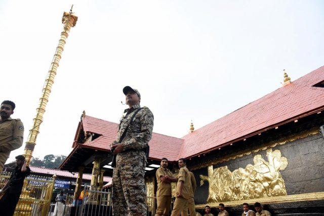 Pathanamthitta: A security personnel stands guard at the Sabarimala temple in Kerala's Pathanamthitta district on Nov 17, 2018. A Hindu group on Saturday called for a shutdown in Kerala following the