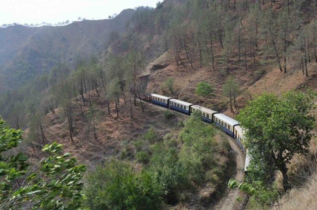 A train chugs on the British-era Unesco heritage Kalka-Shimla rail track. (File Photo: IANS) by .