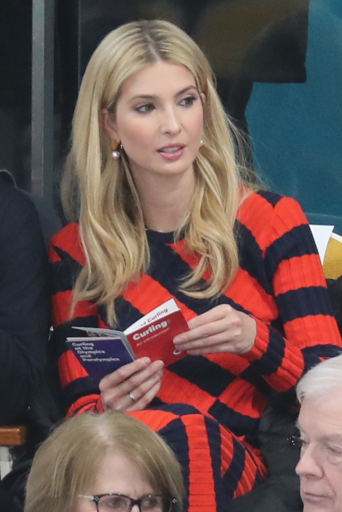 Gangneung: With a booklet on the sport of curling in her hands, Ivanka Trump, the U.S. president's daughter and senior advisor, watches the men's curling final between the United States and Sweden at the PyeongChang Winter Olympics in Gangneung, on South Korea's east coast, on Feb. 24, 2018.(Yonhap/IANS) by .