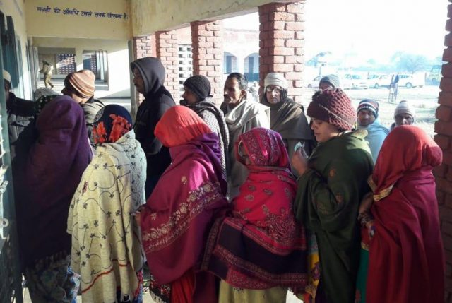 Jind: People wait in a queue to cast their votes for Haryana's lone Jind seat assembly bypoll on Jan 28, 2019. (Photo: IANS) by .