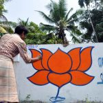 An artist makes graffiti of BJP in Kochi ahead of Kerala assembly polls. (File Photo: IANS) by .