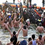 Prayagraj: Ascetics take a holy dip at Sangam -- the confluence of rivers Ganga, Yamuna and the mythical Saraswati -- to mark the onset of the Kumbh Mela on the auspicious day of Makar Sankranti in Prayagraj, on Jan 15, 2019. (Photo: IANS) by .
