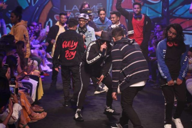Mumbai: Actor Ranveer Singh and rapper Naezy perform during Gully Gen's show at Lakme Fashion Week (LFW) Summer/Resort 2019 in Mumbai, on Feb 3, 2019. (Photo: IANS) by .