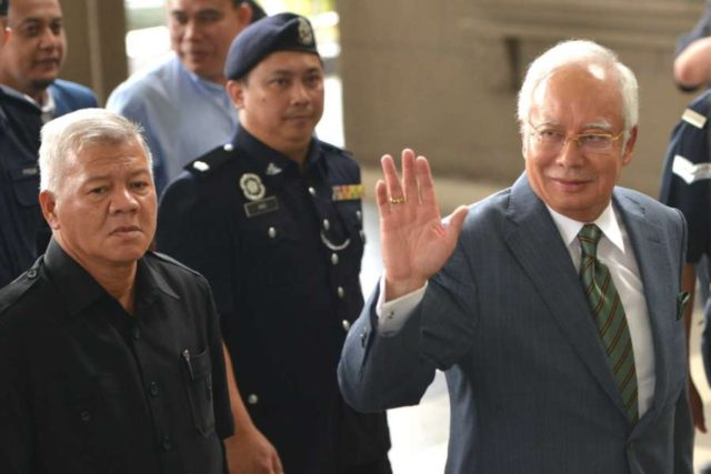 KUALA LUMPUR, Aug. 8, 2018 (Xinhua) -- Former Malaysian Prime Minister Najib Razak (R) appears at the Kuala Lumpur Courts complex in Kuala Lumpur in Malaysia, Aug. 8, 2018. Former Malaysian Prime Minister Najib Razak on Wednesday was charged with three offenses related to money-laundering and anti-terrorism financing, in addition to several counts of criminal breach of trust and corruption charges that were served in early July. (Xinhua/Chong Voon Chung/IANS) by .