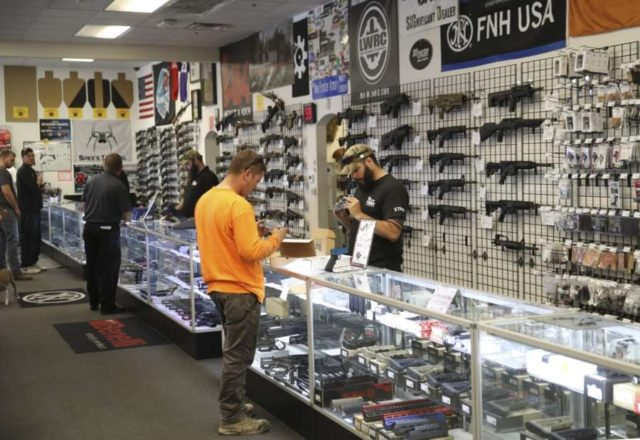 LAS VEGAS, Oct. 5, 2017 (Xinhua) -- People purchase firearms in a gun shop in Las Vegas, the United States, on Oct. 4, 2017. In the wake of the worst mass shooting in U.S. history, Democrats on Wednesday began a push to tighten gun control, although they are unlikely to get far, experts said. (Xinhua/Wang Ying/IANS) by .
