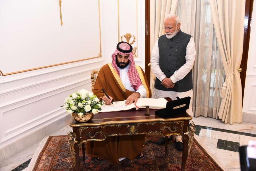 New Delhi: Saudi Crown Prince Mohammed bin Salman signs the Visitor's Book as Prime Minister Narendra Modi looks on, at Hyderabad House, in New Delhi, on Feb 20, 2019. (Photo: IANS/MEA) by .