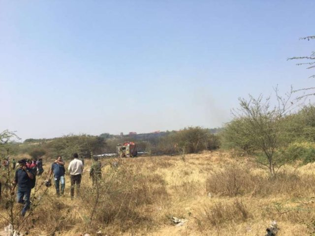Bengaluru: The site where an IAF aircraft crashed in Yemalur, a village near Bengaluru on Feb 1, 2019. (Photo: IANS) by .