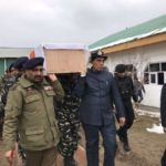Union Home Minister Rajnath Singh lifts the coffin of one of the one of the 45 CRPF personnel killed in a suicide attack by militants in Jammu and Kashmir's Pulwama district on 14th Feb 2019; in Budgam of Jammu and Kashmir, on Feb 15, 2019. (Photo: @rajnathsingh/Twitter) by .