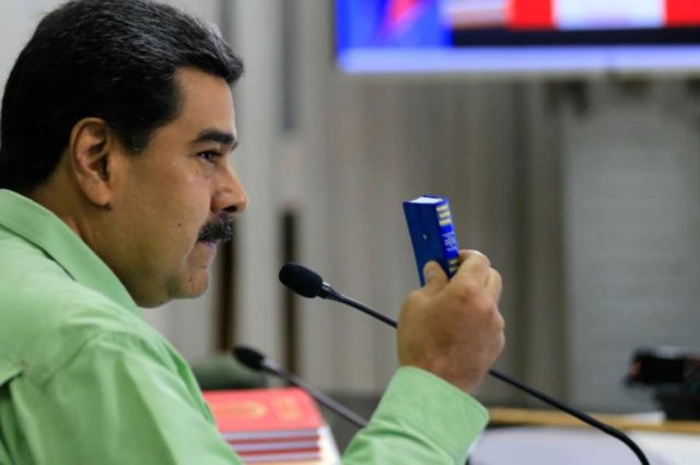CARACAS, Feb. 22, 2019 (Xinhua) -- Image provided by Venezuela's Presidency shows Venezuelan President, Nicolas Maduro, taking part in a meeting with the high command of the National Bolivarian Armed Forces, in Caracas, capital of Venezuela, Feb. 21, 2019. Maduro on Thursday ordered the country's southern border with Brazil be sealed off. The measure will be in effect until further notice, the president said during a meeting with the high command of the National Bolivarian Armed Forces. The move comes amid what he called