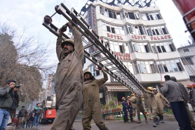 New Delhi: Fire service officials try to douse fire at Arpit Palace Hotel in Karol Bagh, New Delhi on Feb. 12, 2019. A child and 16 others, including a woman was killed in a major fire that engulfed several storeys of this central Delhi hotel. (Photo: IANS) by .
