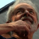 SAO BERNARDO DO CAMPO, April 8, 2018 (Xinhua) -- Former President of Brazil Luiz Inacio Lula da Silva reacts during a mass in memory of his wife Marisa Leticia in front of the headquarters of the Metalworkers' Union in Sao Bernardo do Campo, in the outskirts of Sao Paulo, Brazil, on April 7, 2018. Brazil's ex-president Luiz Inacio Lula da Silva turned himself in to federal police on Saturday, after supporters tried to prevent him from handing himself over to the authorities. (Xinhua/Rahel Patrasso/IANS) by .