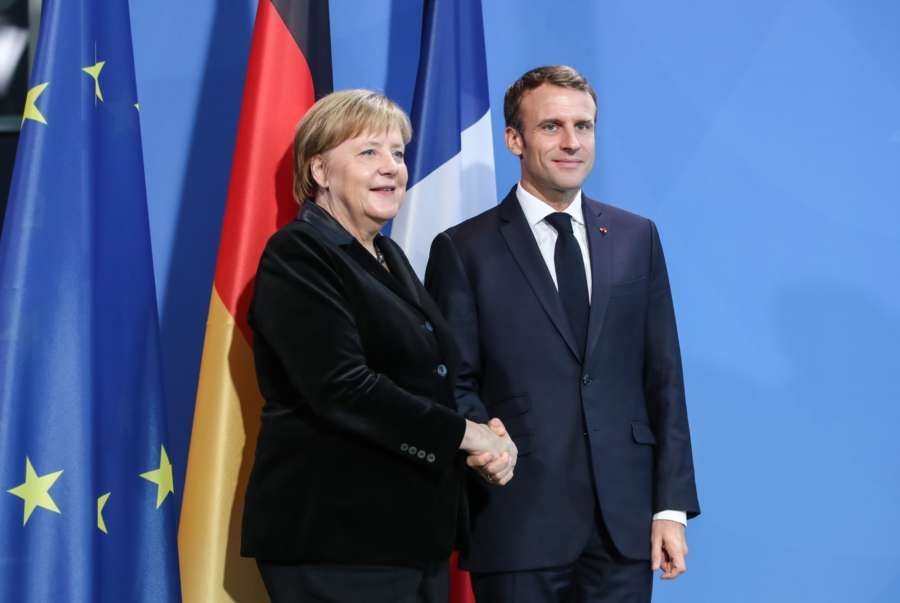 BERLIN, Nov. 18, 2018 (Xinhua) -- German Chancellor Angela Merkel (L) shakes hands with French President Emmanuel Macron after a joint press conference at German Chancellery in Berlin, capital of Germany, on Nov. 18, 2018. Visiting French President Emmanuel Macron on Sunday addressed German legislators, calling for opening a new chapter for Europe and building it more integrated, stronger and independent. Macron visited Berlin on Sunday to attend a series of events to mark Germany's Day of Mourning for war and violence victims, and met with German Chancellor Angela Merkel. (Xinhua/Shan Yuqi/IANS) by .