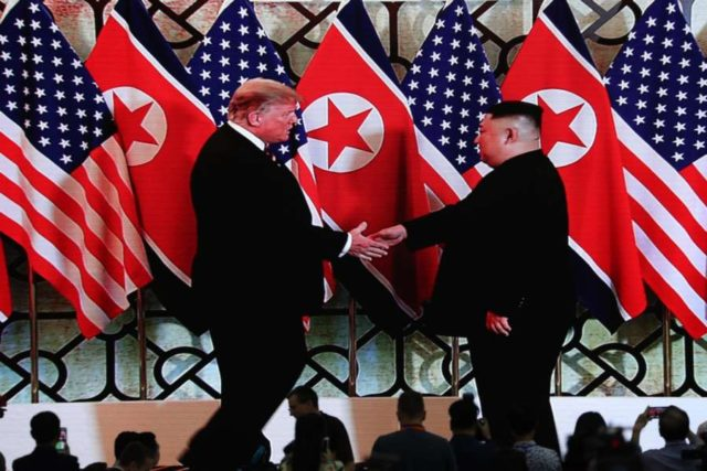 Hanoi: This AP photo shows U.S. President Donald Trump (L) and North Korean leader Kim Jong-un smiling before a summit meeting at the Sofitel Legend Metropole Hanoi on February 27, 2019. (Yonhap/IANS) by .