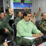 """CARACAS, Feb. 22, 2019 (Xinhua) -- Image provided by Venezuela's Presidency shows Venezuelan President, Nicolas Maduro (C, front), taking part in a meeting with the high command of the National Bolivarian Armed Forces, in Caracas, capital of Venezuela, Feb. 21, 2019. Maduro on Thursday ordered the country's southern border with Brazil be sealed off. The measure will be in effect until further notice, the president said during a meeting with the high command of the National Bolivarian Armed Forces. The move comes amid what he called """"provocation"""" from Brazil's right-wing government. Venezuela is also considering sealing its border with Colombia, he added. (Xinhua/VENEZUELAN PRESIDENCY/IANS) by ."""