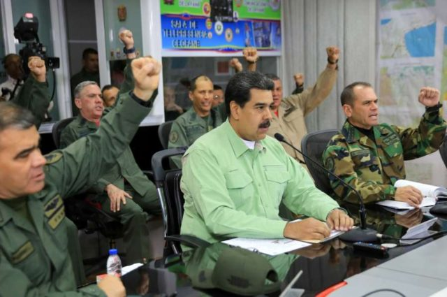 CARACAS, Feb. 22, 2019 (Xinhua) -- Image provided by Venezuela's Presidency shows Venezuelan President, Nicolas Maduro (C, front), taking part in a meeting with the high command of the National Bolivarian Armed Forces, in Caracas, capital of Venezuela, Feb. 21, 2019. Maduro on Thursday ordered the country's southern border with Brazil be sealed off. The measure will be in effect until further notice, the president said during a meeting with the high command of the National Bolivarian Armed Forces. The move comes amid what he called