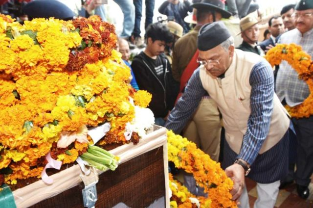 Dehradun: Uttarakhand Chief Minister Trivendra Singh Rawat pays tribute to Major Chitresh Singh Bisht, who lost his life while defusing a landmine along the Line of Control (LoC) in Rajouri district of Jammu and Kashmir; in Dehradun on Feb 18, 2019. (Photo: IANS) by .