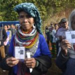 Mamit: Reang tribal refugees, sheltered in Tripura for the past 21 years, show their Voter ID cards as they arrive to cast their votes for Mizoram Assembly elections in Mamit district of Mizoram, on Nov 28, 2018. (Photo: IANS) by .