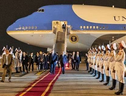 President Donald Trump walks along a red carpet from Air Force One and reviews a guard of honour on his arrival on Tuesday, Feb. 26, 2019, at Noi Bai International Airport in Hanoi. (Photo: White House/IANS) by .