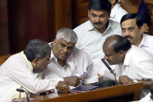 Bengaluru: Karnataka Chief Minister H.D. Kumaraswamy in a conversation with Congress MLA Siddaramaiah during the state assembly's Budget Session, in Bengaluru on Feb 6, 2019. (Photo: IANS) by .