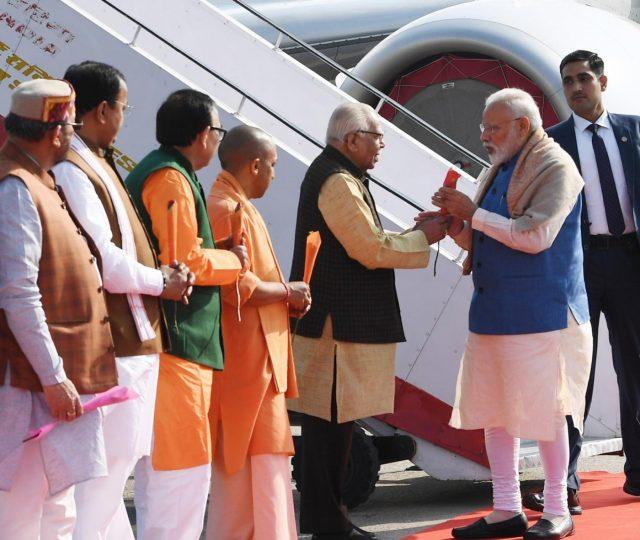 Varanasi: Prime Minister Narendra Modi being welcomed by the Governor of Uttar Pradesh Ram Naik, the Chief Minister of Uttar Pradesh Yogi Adityanath and other dignitaries, on his arrival at Varanasi, Uttar Pradesh on Feb 19, 2019. (Photo: IANS/PIB) by .