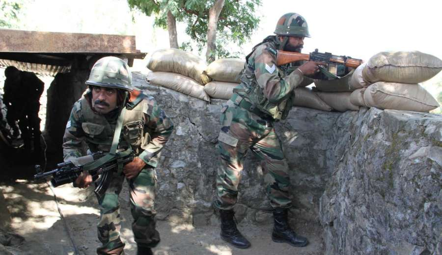 Naushera: Soldiers take position in their bunker at Naushera sector of Jammu and Kashmir where Pakistani forces resorted to heavy firing on Oct 28, 2016. (Photo: IANS) by .
