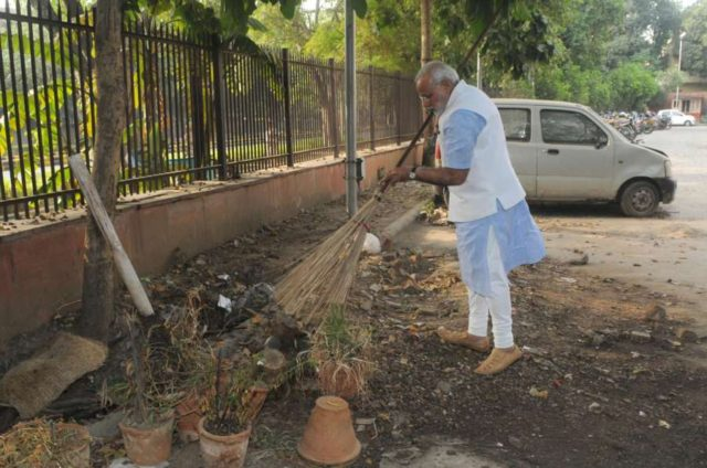 Prime Minister Narendra Modi cleans the premises of Mandir Marg Police Station during his surprise visit, in New Delhi, on Oct. 2, 2014. (Photo: IANS/PIB) by .