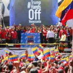 """CARACAS, Feb. 24, 2019 (Xinhua) -- Image provided by Venezuela's Presidency shows President Nicolas Maduro attends a pro-government rally in Caracas, capital of Venezuela, on Feb. 23, 2019. Venezuelan President Nicolas Maduro announced on Saturday severance of diplomatic and political relations with neighboring Colombia, following the latter one's support for Venezuela's right-wing opposition and military defectors. """"I have decided to break off all types of political and diplomatic ties with the fascist government of Colombia,"""" Maduro told a pro-government rally in Caracas. (Xinhua/Venezuelan Presidential Office/IANS) by ."""