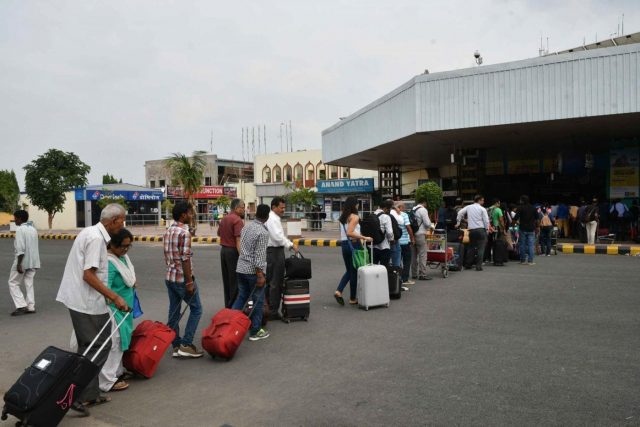 Patna: Passengers stranded outside Jay Prakash Narayan Airport as flights get delayed due to bad weather in Patna, on June 29, 2018. (Photo: IANS) by .