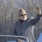 Prime Minister Narendra Modi waves his hand while taking a boat ride in Srinagar's Dal Lake on Jan 3, 2019. by .
