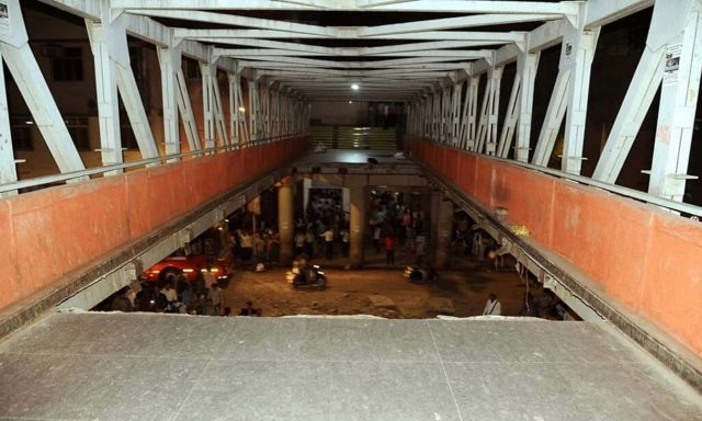 Mumbai: At least 12 commuters were injured when a portion of a pedestrian bridge crashed near the Chhatrapati Shivaji Terminus in Mumbai on March 14, 2019. (Photo: IANS) by .