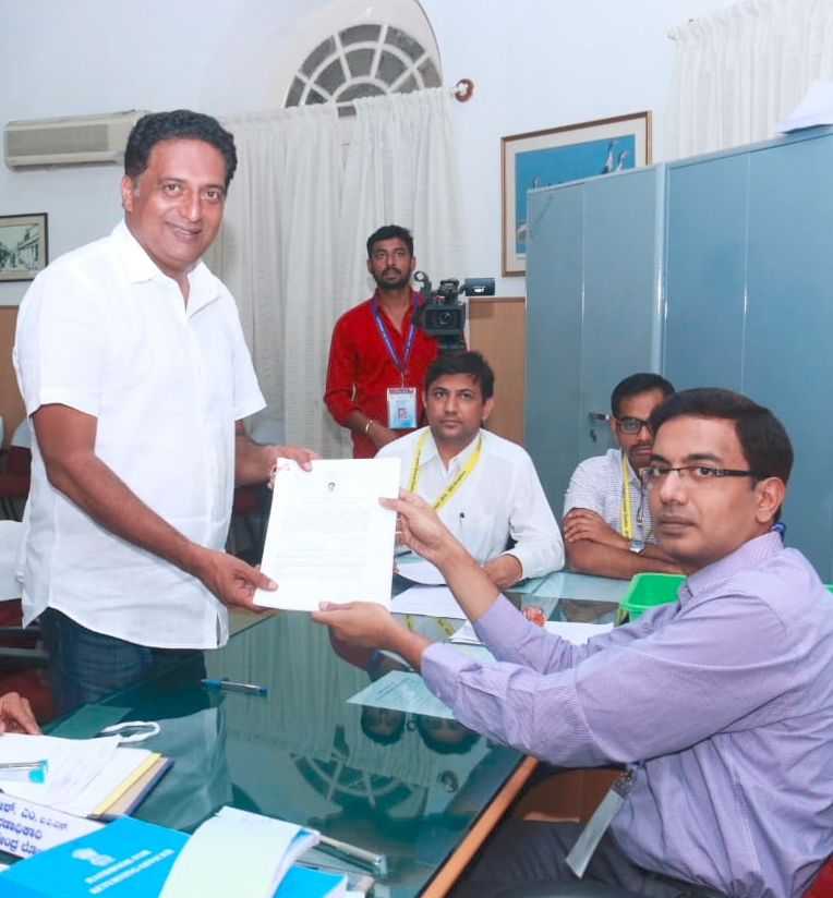 Bengaluru: Actor Prakash Raj who is contesting as an independent candidate from Bangalore Central for the 2019 Lok Sabha elections, submits his nomination papers to District Election Officer Lokesh Kumar in Bengaluru, on March 22, 2019. (Photo: IANS) by .