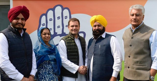 New Delhi: Congress President Rahul Gandhi welcomes Ferozepur MP Sher Singh Ghubaya into the party in New Delhi, on March 5, 2019. Also seen Punjab Congress President Sunil Jakhar. (Photo: IANS/AICC) by .