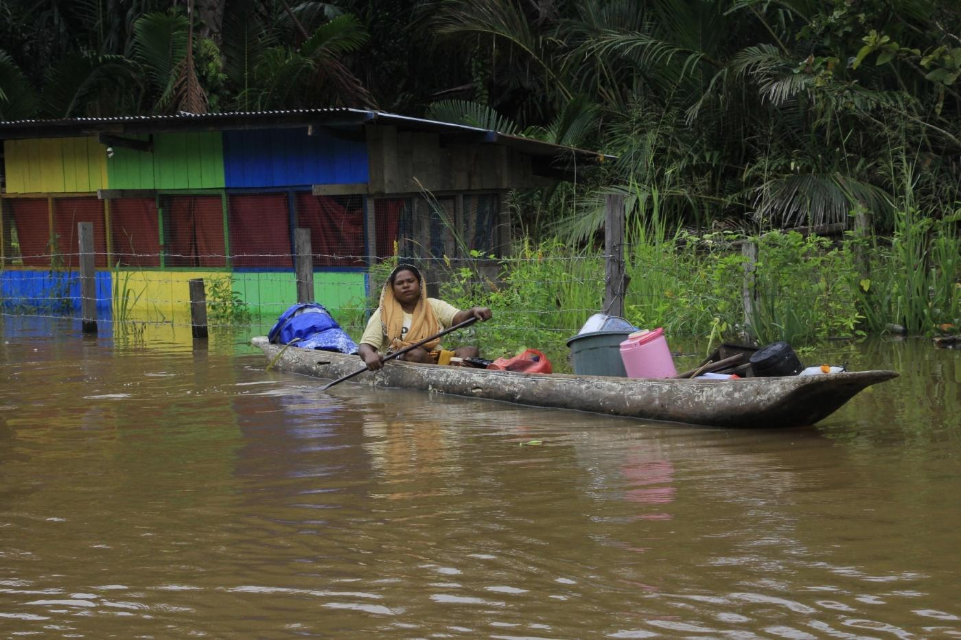 SENTANI, March 20, 2019 (Xinhua) -- A woman rides a boat through flood water in Sentani, Papua province, Indonesia, March 19, 2019. Indonesian disaster authorities have put the death toll of flash floods and landslides in eastern province of Papua at 89 while the search and rescue operation for 74 missing persons continues, official said here on Tuesday. (Xinhua/Ikha/IANS) by .